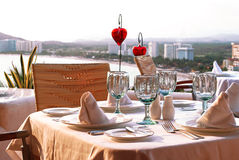 Dinner table with bay view Royalty Free Stock Photos