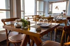 Dinner table at a beach restaurant. Nicely set table at a beach restaurant royalty free stock photo