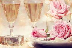 Dinner table with beautiful pink roses Royalty Free Stock Photos