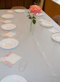 Dinner table in a church. With red rose Royalty Free Stock Image