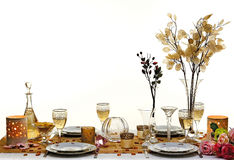 Dinner table. Decorated dinner table with fancy dinner set and wine on white background stock photos