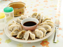 On the Dinner table dumplings. These Chinese dumplings (jiaozi) are filled with meat, cabbage, and other seasonings, and then steamed or boiled. The traditional Stock Photography