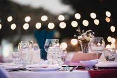 Dinner table,Empty glasses set in restaurant stock photography
