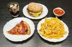 Dinner. A table with fast food. Royalty Free Stock Images