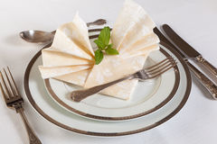 Dinner table with festive napkins Stock Photography