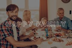 Dinner Table Filled with Food. Thanksgiving Day. Family Traditional Dinner. Relatives Spend Time Together. Happy Family Eat Delicious Food. Baked Turkey on royalty free stock photo