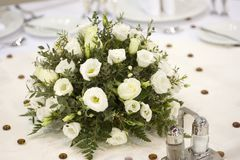 Dinner table with flowers Stock Photo