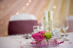Dinner table with flowers Royalty Free Stock Image