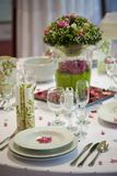 Dinner table with flowers Royalty Free Stock Photos