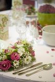 Dinner table with flowers Royalty Free Stock Photo