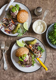 Dinner table - homemade burgers and coleslaw. Top view royalty free stock photo