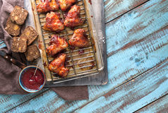 Dinner table with homemade chicken wings and cranberry sauce Royalty Free Stock Image