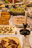 Dinner table with hummus, Carrot salad, Circassian chicken, Avocado Salad, Egg Rolls. At home Stock Images