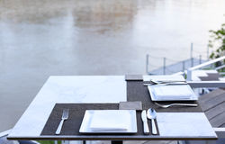 Dinner table at riverside Stock Images