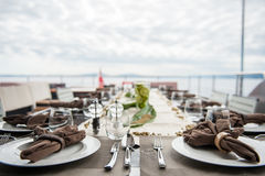 Dinner table by sea Stock Photo