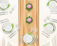 Dinner Table Set Up. Background with top view of table covered with festive tablecloth and decorated by flowers realistic vector illustration Royalty Free Stock Image