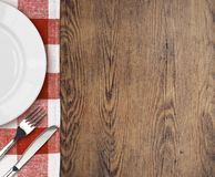 Dinner table with setting plate and cutlery top Stock Photo