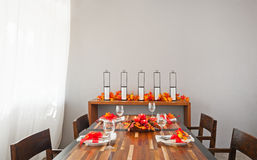 Dinner table setting in warm orange red colors Stock Images