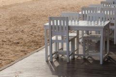 Dinner table setup on tropical beach Stock Photos