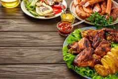 Dinner table with variety food.Copy space. Stock Photos