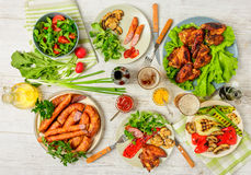 Dinner table with variety food Royalty Free Stock Photos