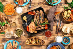 Dinner table with variety food grilled, top view Royalty Free Stock Photo