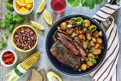 Dinner table, beef, vegetable, mix, grilled, steak, wine, barbecue, stone, background concept food, top view. Dinner table, vegetable mix with grilled beef and royalty free stock photography