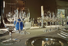 Dinner Table With Wine Glasses. A formal dinner table set with mulitiple wine glasses for a wine tasting party Royalty Free Stock Image