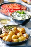 Dinner Table With Baked Potatoes Stock Image