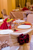 Dinner table01. Fancy table set for a wedding dinner, focus on the ribbon Stock Image
