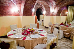 Dinner table03. Fancy table set for a wedding dinner, in an ancient, brick wall location Royalty Free Stock Image