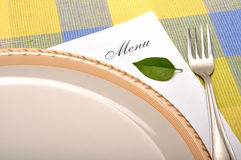 Dinner time. Menu card with plate on mat Royalty Free Stock Photo