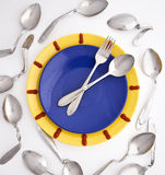 Dinner time. The composition simulating a wall clock, consisting of tablewares Stock Image