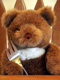 Dinner Time. Teddy bear with fork ready to eat dinner Royalty Free Stock Photos