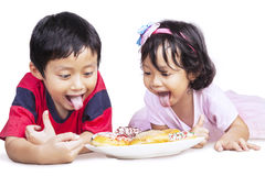 Dinner time with brother and sister isolated Royalty Free Stock Photos