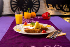 Dinner time - fried cheese. Fried cheese with side dish, shoot in a retro looking restaurant Stock Photo