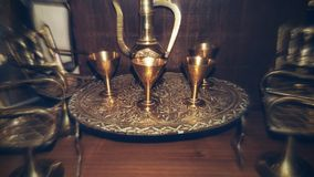 Dinner time. Gold table with goblets Royalty Free Stock Photo