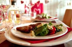 Dinner time. Dinner plate nice set up bacon restaurant napkin glass salad Stock Image