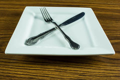 Dinner time. An dinner plate and utensil on a  table Royalty Free Stock Image