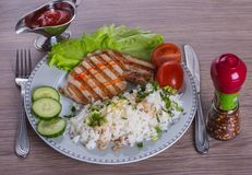 Dinner time. Steak with rice Royalty Free Stock Photo