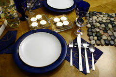 Dinner for two. Wooden table with everything ready for occasional dinner (perspective view Stock Photography