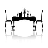 Dinner for two. Silhouette of a romantic table setting for two. Black and white with reflection and space for your text Stock Photo