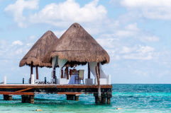 Dinner for Two. All set for couple's romantic date on wooden pier. Table setting for two overlooking the Mexican Caribbean on Riviera Maya Royalty Free Stock Photography
