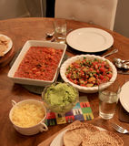 Dinner for two - salsa salad with taco mix guacamole and cheese. Plus pita bread Royalty Free Stock Image