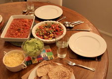 Dinner for two - salsa salad with taco mix guacamole and cheese. Plus pita bread Royalty Free Stock Photos