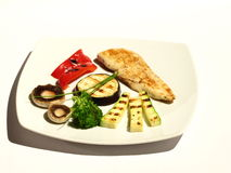 Dinner, veggies and chicken. Served plate, chicken meat with veggies. Fine dining Royalty Free Stock Image