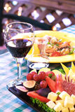 Dinner and Wine. Glass of wine with dinner and appetizer Royalty Free Stock Images