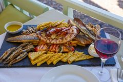 Dinner with wine and seafood. By the sea royalty free stock photos