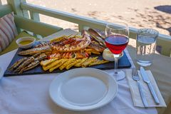 Dinner with wine and seafood. By the sea stock images