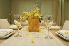 Dinnertable. With cups, flower vase, and plates royalty free stock photography